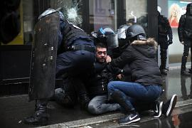 A protestor is arrested by riot police officers during a demonstration on Thursday, 9 January 2020.