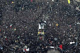 The coffins of Gen. Qassem Soleimani and others who were killed in Iraq by a U.S. drone strike, are carried on a truck surrounded by mourners during a funeral procession.
