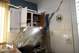 The inside of 67 year-old William Mercuchi's home that was destroyed by magnitude 6.4 quake, that leaved hundreds of people homeless or temporarily displaced.
