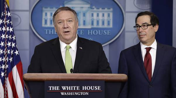 Secretary of State Mike Pompeo and Treasury Secretary Steve Mnuchin at the White House, Friday, Jan. 10, 2019, in Washington. (AP Photo/ Evan Vucci