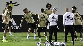 Real Madrid players warm up during a training session in Jiddah, Saudi Arabia