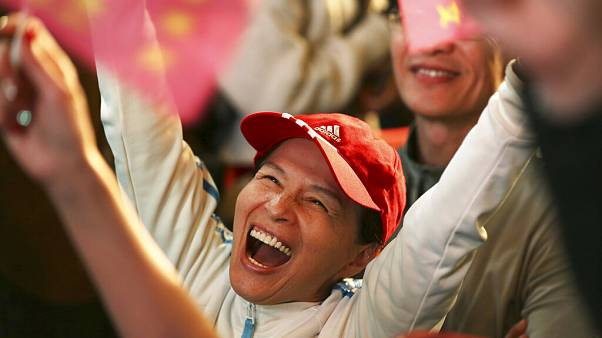 Taiwan's president wins second term after landslide election win