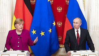 Angela Merkel met Vladimir Putin at the Kremlin
