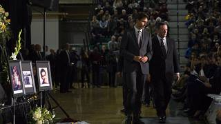 Justin Trudeau, left, arrives with Alberta Premier Jason Kenney during a memorial for the victims of the Ukrainian plane disaster in Iran
