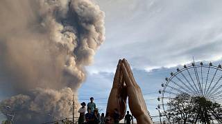 People watch as Taal volcano spews ash and smoke during an eruption in Tagaytay, Cavite province south of Manila, Philippines. 12 January 2020.