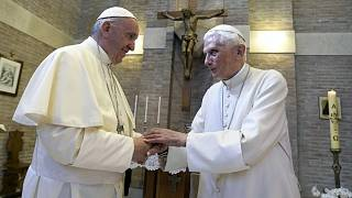 Pope Francis, left, and Pope Emeritus Benedict XVI, meet each other on the occasion of the elevation of five new cardinals