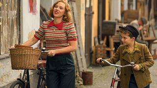 Scarlett Johansson and Roman Griffin Davis in the film JOJO RABBIT.