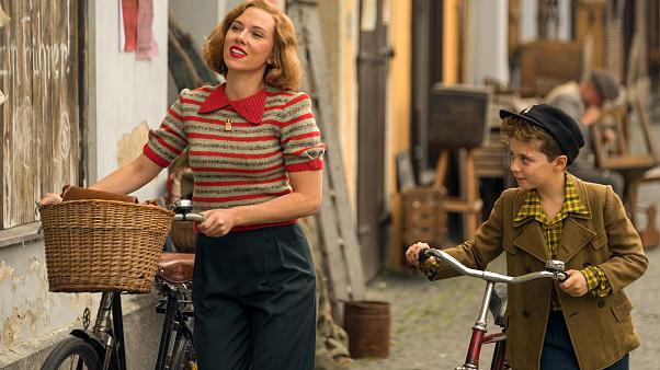 Scarlett Johansson and Roman Griffin Davis in the film JOJO RABBIT.