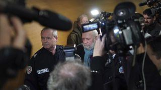 Former French priest Bernard Preynat, center, arrives at the Lyon court house, central France, Monday Jan.13, 2020.