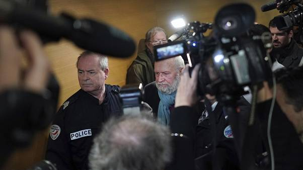 Former French priest Bernard Preynat, center, arrives at the Lyon court house, central France, Monday Jan.13, 2020.