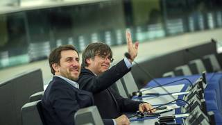 Catalan leaders Carles Puigdemont and Antoni Comin attend a plenary in the hemicycle of the European Parliament in Strasbourg