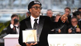 Spike Lee with his Grand Prix award at Cannes in 2018