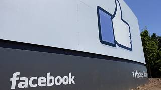 FILE - This July 16, 2013 file photo shows a sign at Facebook headquarters in Menlo Park, California
