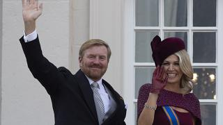 Dutch King Willem-Alexander and Queen Maxima wave from the balcony of royal palace Noordeinde in The Hague, Netherlands, Tuesday, Sept. 17, 2019