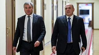 Putin's nominee for Russia PM Mikhail Mishustin, right, with Russian State Duma speaker Vyacheslav Volodin