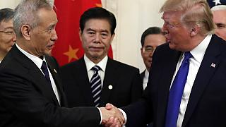 """President Donald Trump and Chinese Vice Premier Liu He sign """"phase one"""" of a US China trade agreement"""
