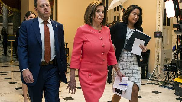 House Speaker Nancy Pelosi of Calif., centre, walks towards the House Chamber on Capitol Hill, Wednesday, Jan. 15, 2020, in Washington.