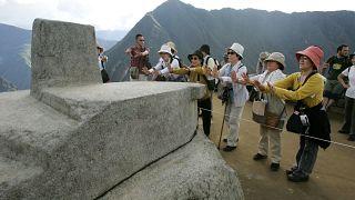 People tour the ruins of Machu Picchu near Cuzco, Peru  March 26, 2008 file photo