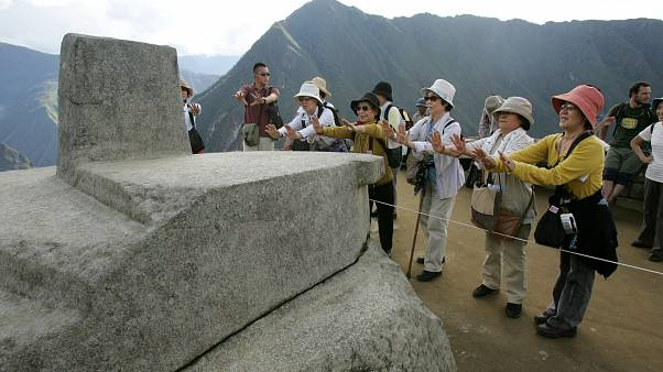 People tour the ruins of Machu Picchu near Cuzco, Peru  March 26, 2008 file photo