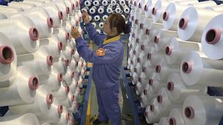 An employee works in a chemical fiber plant in Nantong in eastern China's Jiangsu Province