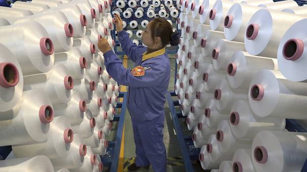 An employee works in a chemical fiber plant in Nantong in eastern China's Jiangsu Province