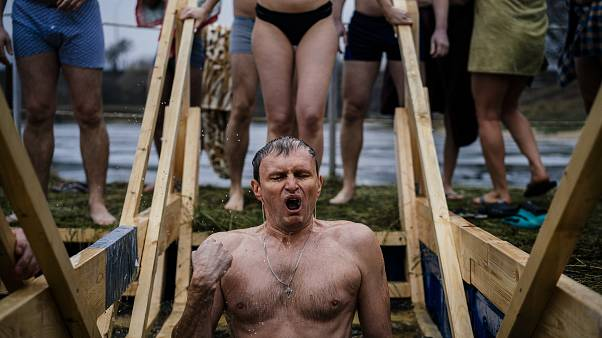 Russians mark Epiphany with plunge into icy water