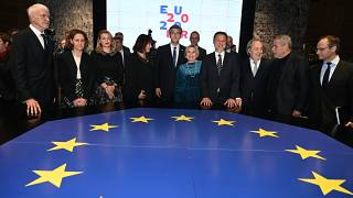 Croatian Prime Minister Andrej Plenkovic (C) with his associates pose for a photograph in Croatia's National and University Library