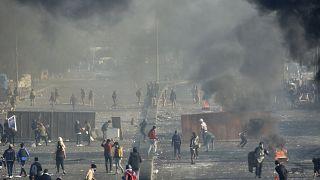 مواجهات عنيفة بين متظاهرين و قوات الأمن في بغداد