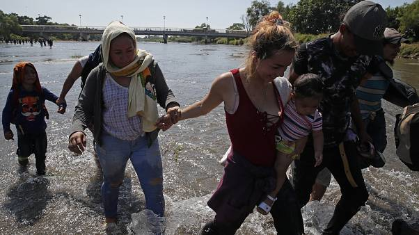 Migrants cross river from Guatemala to Mexico