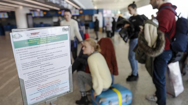 A notice explaining precautions to be taken by people traveling to Wuhan, China, is seen at a terminal of Rome's International Fiumicino airport, Tuesday, Jan. 21, 2020.