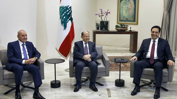 Lebanese President Michel Aoun, center, meets with Prime Minister-Designate Hassan Diab, right,  at the Presidential Palace, Lebanon, Tuesday, Jan. 21, 2020.