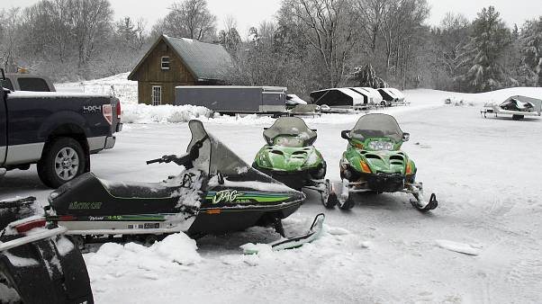 In this Dec. 10, 2014 photo, snowmobiles sit in the yard of Champlain Valley Motorsports in Cornwall, Vt.