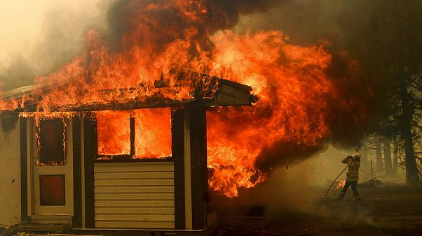 A firefighter battles the Morton Fire as it consumes a home near Bundanoon, New South Wales, Australia. January 23 2020
