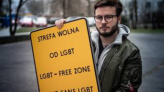 "Bart Staszewski with a ""LGBT-FREE ZONE"" sign he created for his campaign."