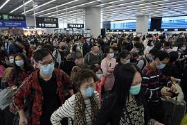Passengers wear protective face masks at the departure hall of the high-speed train station in Hong Kong. 23 January 2020.