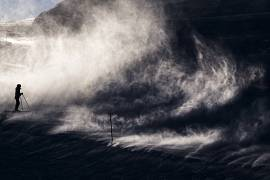 Skiers make their way in strong winds, in Leysin, Switzerland.