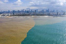 Mud water from Hayarkon river flows in to the Mediterranean Sea in Tel Aviv, Israel.