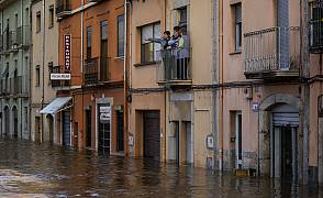 People stand at a balcony during floodings following a storm in Girona, Spain. 23 January 2020.