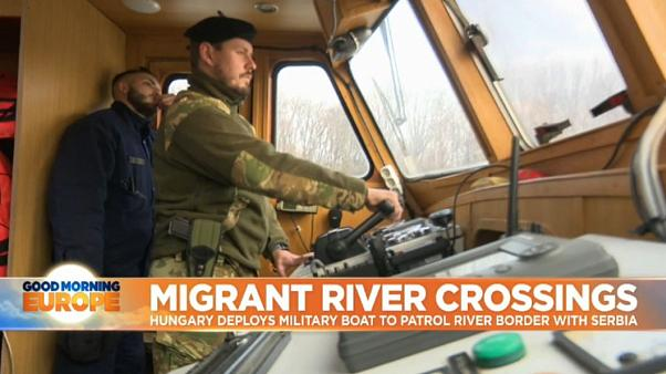 Hungary launches armed river patrols to catch swimming migrants
