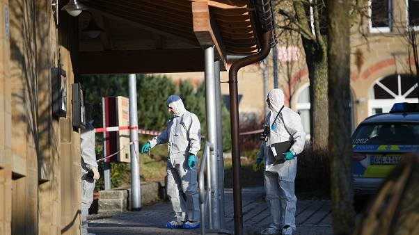German forensic policemen work at a house after a shooter launched an assault on January 24, 2020 in Rot am See in southwestern Germany
