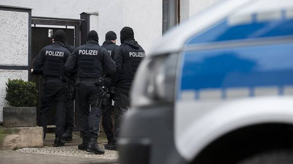 Police stand in front of an apartment building in Erfurt as they carried out raids on the day Germany banned the neo-Nazi group 'Combat 18' Deutschland, Jan. 23, 2020.