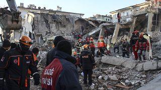 Rescue workers work to save people trapped under debris in Elazig, eastern Turkey, Sunday, Jan. 26, 2020.