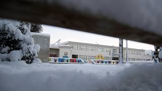 The yard of an elementary school is covered with snow in northern Athens, Tuesday, Jan. 8, 2019