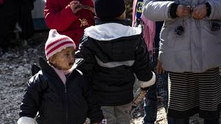 Orphans, from various nationalities including two French (L, 2-L) gather at the Kurdish-run al-Hol camp. January 25, 2020