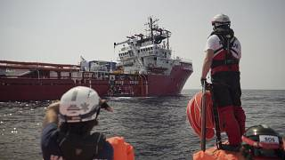 A rescuer waits for orders from the Ocean Viking in the Mediterranean Sea, Tuesday, Sept. 17, 2019.