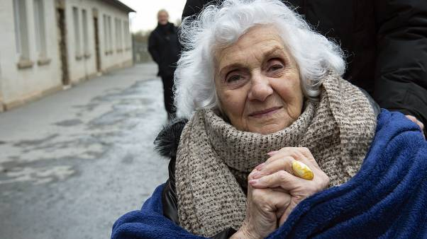 Nazi concentration camp survivor Eva Pusztai of Hungary People is being photographed after a wreath ceremony on occasion of the international Holocaust remembrance day.