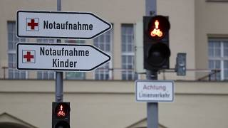 Signposts stand in front main entrance of hospital 'Klinikum Schwabing' in Munich, Germany, Tuesday, Jan. 28, 2020.