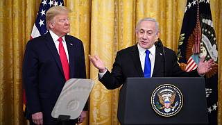 Israeli Prime Minister Benjamin Netanyahu, with US President Donald Trump, speaks during an announcement of Trump's Middle East peace plan in White House on January 28, 2020
