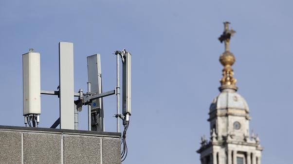 Mobile network phone masts are visible in front of St Paul's Cathedral in the City of London, Tuesday, Jan. 28, 2020