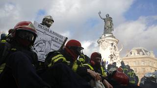 Firefighters gather for a demonstration Tuesday, Jan. 28, 2020 in Paris to demand a better pay and working conditions